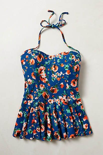 Mix-and-Match Peplum Tankini from Anthropologie / This would look super cute with some high waisted light colored jean shorts and any kind of sandals!