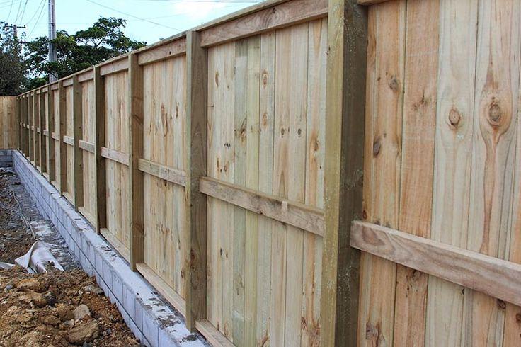 Plain board wooden fence on a brick wall (back-side)