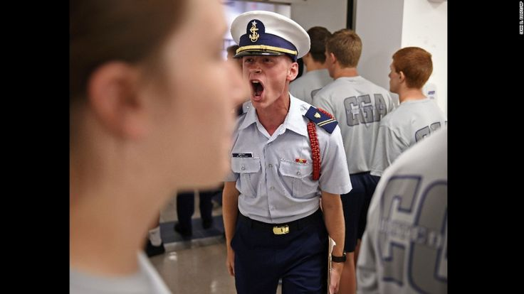 U.S. Coast Guard Academy cadet Ryan Brumm shouts at members of Whiskey Two swab company as they march into the wardroom for lunch on June 26 in New London, Connecticut