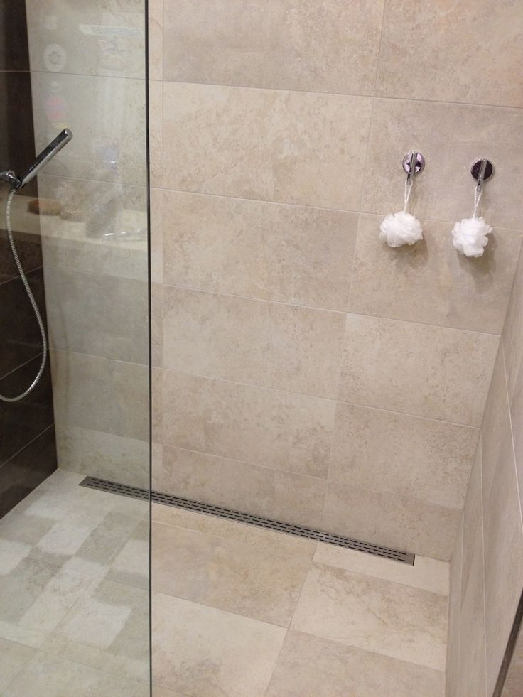 Functional simple design curbless 12x24 tile shower for Bathroom designs using mariwasa tiles