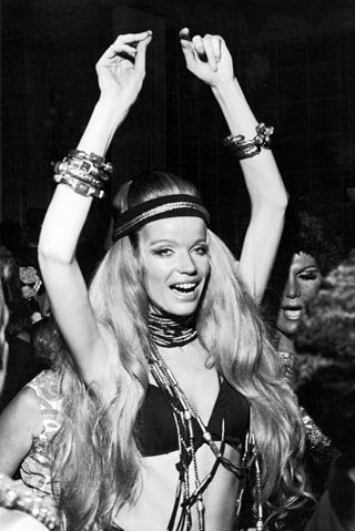 1960s Hippie-style Veruschka - Most women dress up like Veruschka because she was known for her elegant, regal, exotic, dangerous alternative style. They often wore just bra or sometimes without it, accessories, headband.