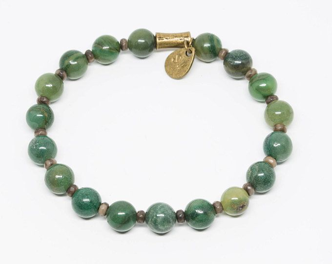 African Jade & Petrified Wood with Hand-stamped Pendant - African-inspired beaded bracelets supporting wildlife conservation by wildlife photographer Shannon Wild.