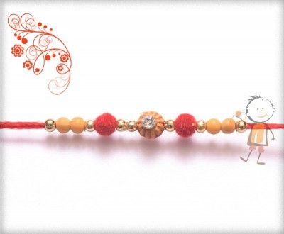 Online #Rakhi #Shopping 2015:- Buy Rakhi, Velvet Rakhi Delivery In #India #USA #UK #Australia #Canada #Dubai #Singapore #NZ Diamond with Red Velvet Beads Rakhi, surprise your loved ones with roli chawal, chocolates and a greeting card as it is also a part of our package and that too without any extra charges.  http://www.bablarakhi.com/send-designer-rakhi-online/1132-send-diamond-with-red-velvet-beads-rakhi-online.html