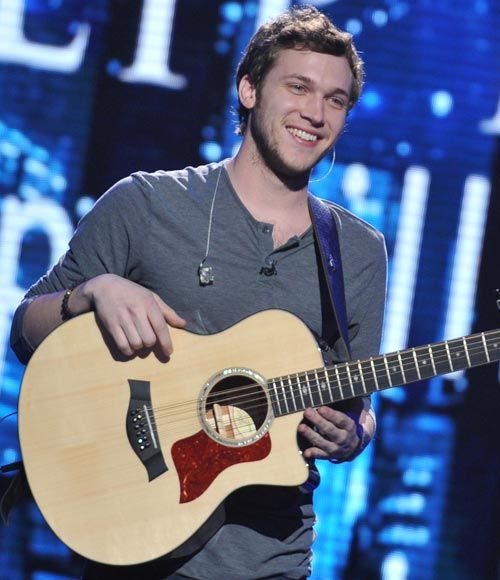 TV Fashion * Show: American Idol * Contestant: Phillip Phillips * Top: John Perse * Pants: Lucky Brand * Bracelet: M. Cohen * Shoes: Frye