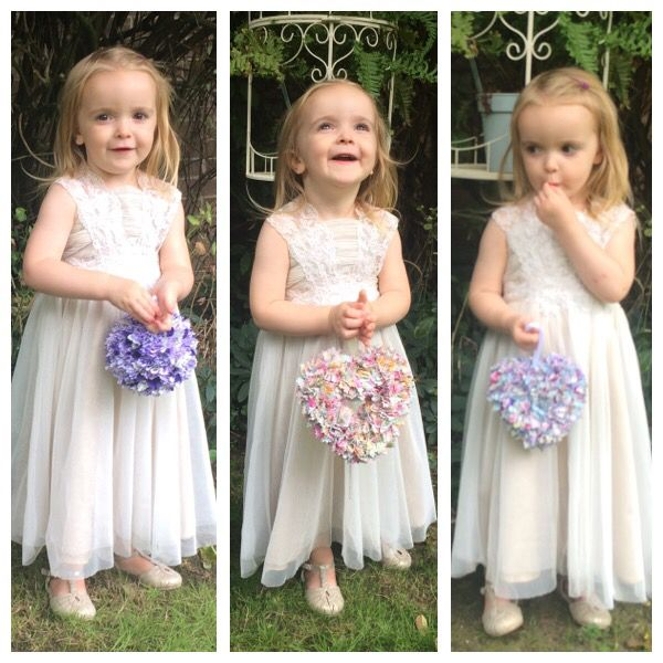Frosies (fabric posies) make a great alternative to fresh flowers for little bridesmaids. They're hard wearing so can be swung around, thrown on the floor and still look pretty for all the photos and can be taken home and kept as a room decoration afterwards.  Contact me at www.handmadecraftcompany.co.uk for more info.