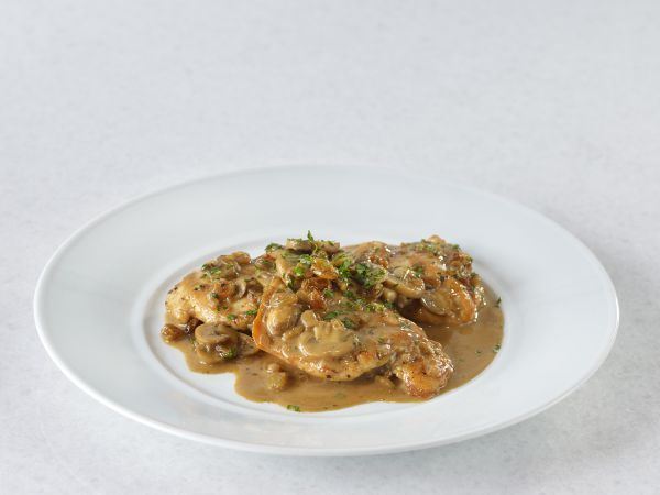 Chicken Scaloppini Marsala with Mushrooms - One of the most popular dishes you'll find on the menus of Italian restaurants is incredibly easy to make at home—especially since Chef Wolfgang Puck shows you his trick for combining regular white wine and seedless raisins when you can't find Marsala, the famous fortified wine from Sicily. The cooking method and sauce in this lesson also work very well with scaloppini of turkey breast, pork, or veal. Get this recipe   through the link in the image