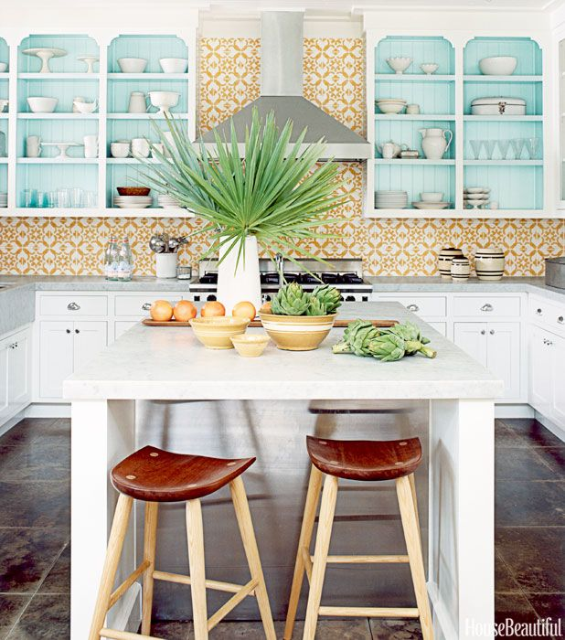 The Moorish-patterned yellow-and-white tiles create a vibrant — and practical — wall surface.