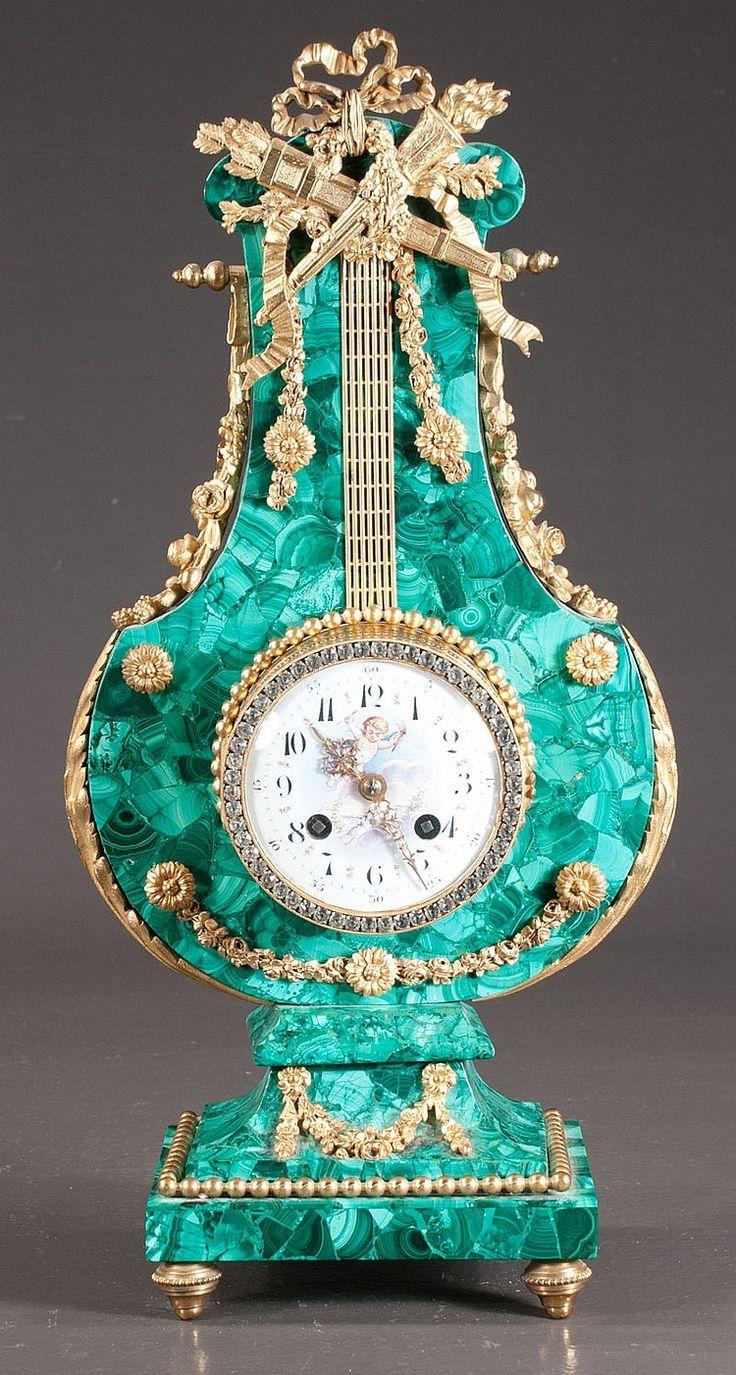 "beautyandtheharpsichord: "" beautyandtheharpsichord Louis XV lyre shape malachite mantle clock with bronze ormolu mounts, c.1890 """