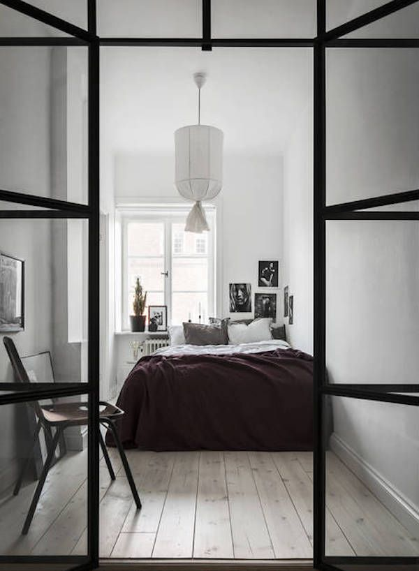 A fabulous bedroom with window wall dividers in a beautiful, elegant small space apartment in Stockholm - Bo Sthlm.