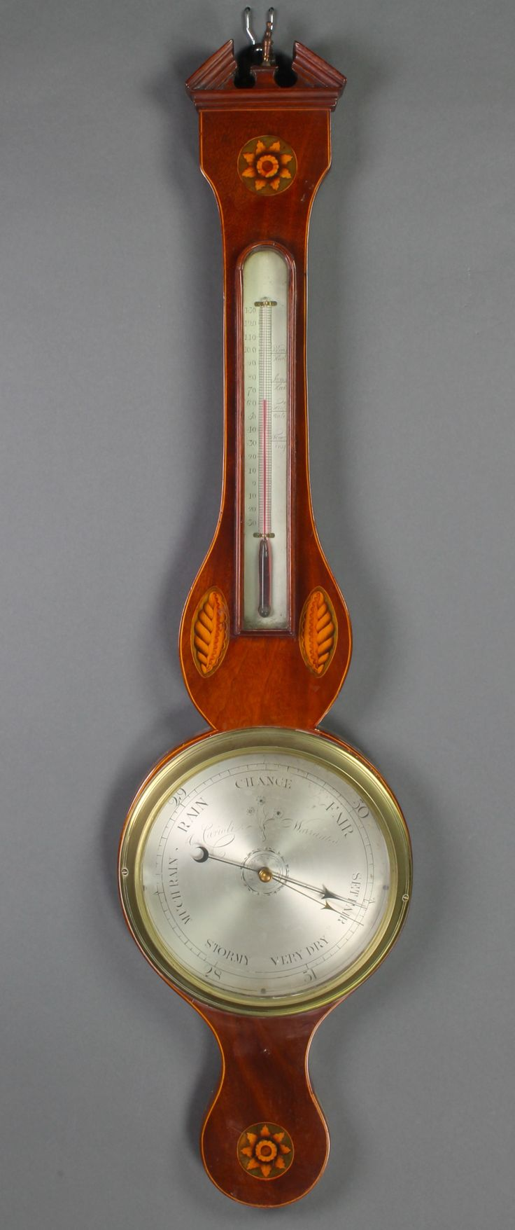 Lot 1083, A 19th Century mercury wheel barometer and thermometer contained in an inlaid mahogany case with broken pediment and silvered dial, est  £80-120