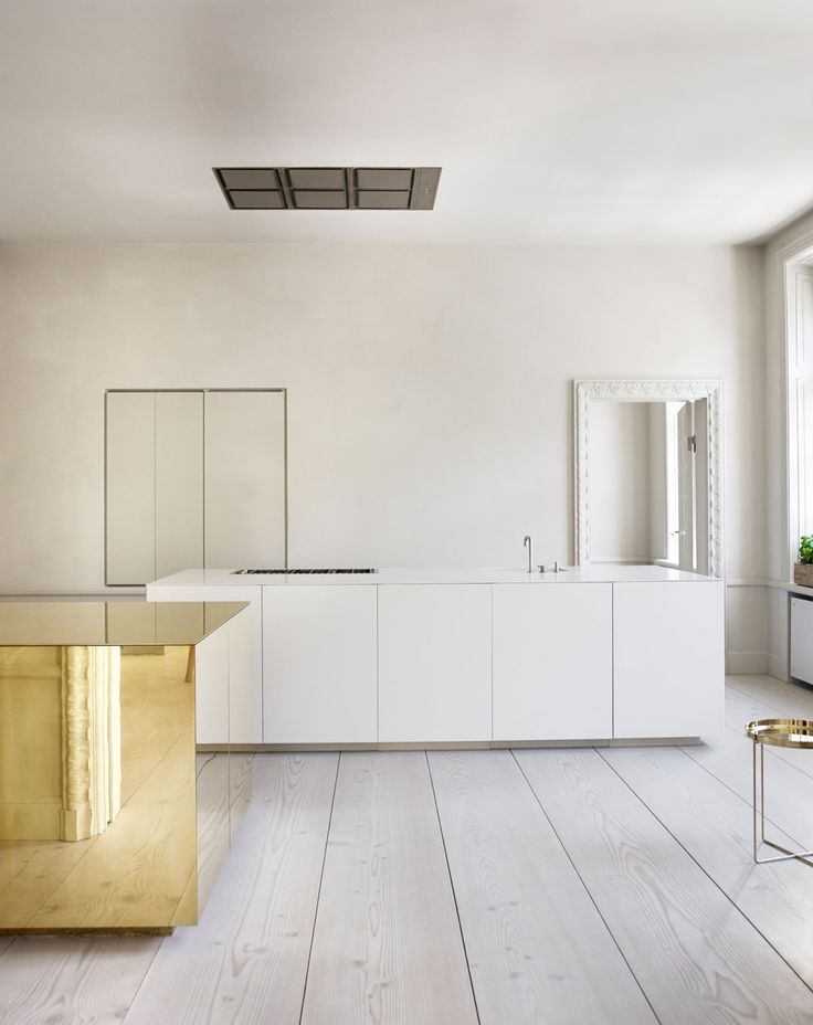 Kitchen Dreams. Minimalist. And a brass cube.