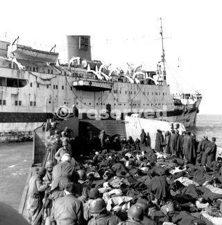 LANDING CRAFT BRINGS WOUNDED TO HOSPITAL SHIP in Anzio bay On the night of 24 January 1944_italy war