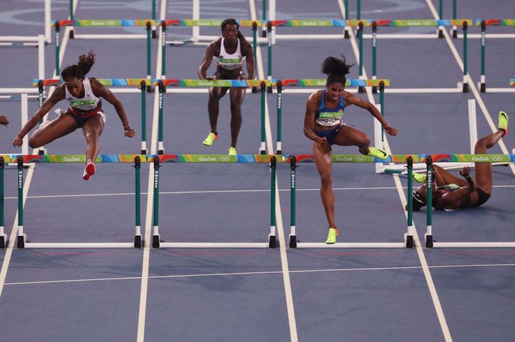 Kristi Castlin (USA) and Cindy Ofili (GBR) compete during the women's 100m hurdles semifinal in the Rio 2016 Summer Olympic Games at Estadio Olimpico Joao Havelange.