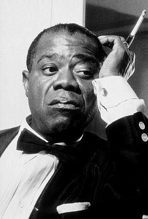 Louis Armstrong....I really like this photograph. So much character.