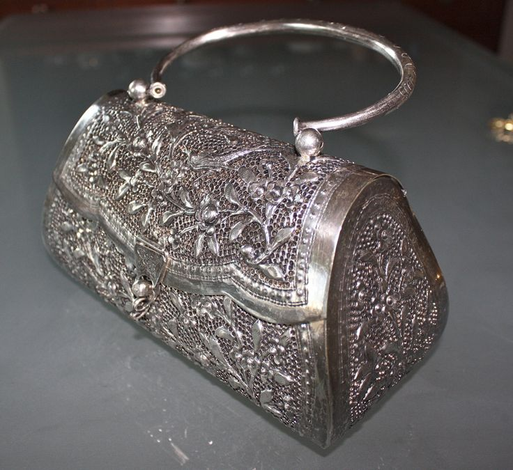 Unique Vintage Open Filigree, Silver Handbag. kind of looks like the new 2014 chanels that are out.