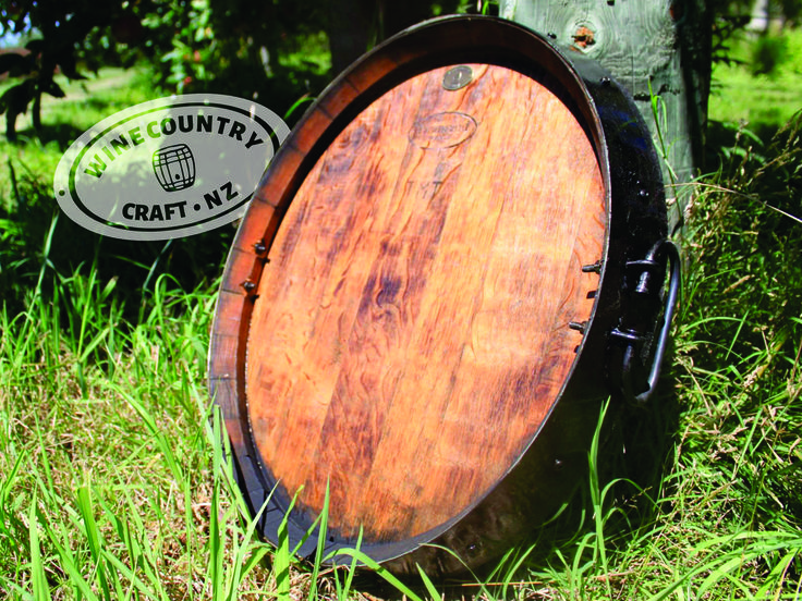 Glorious wine barrel platter crafted using the entire lid of a retired wine barrel from New Zealand.