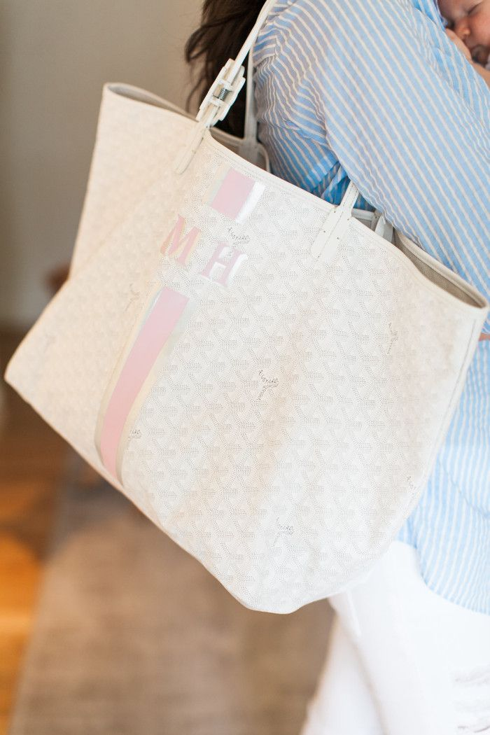 I love this monogrammed Goyard tote bag which I use as a diaper bag. You can order it via phone from Barneys New York.