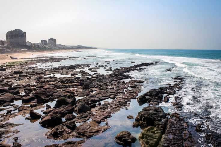 """Rocky shores - Umhlanga is an affluent residential, commercial and resort town north of Durban on the coast of KwaZulu-Natal, South Africa. It is part of the eThekwini Metropolitan Municipality, created in 2000, which includes the greater Durban area. (the correct pronunciation of """"hl"""" in Umhlanga is similar to the Welsh """"ll""""), the name means """"place of reeds"""" in the Zulu language. It is bordered by Durban North to the south and Mt Edgecombe to the west."""