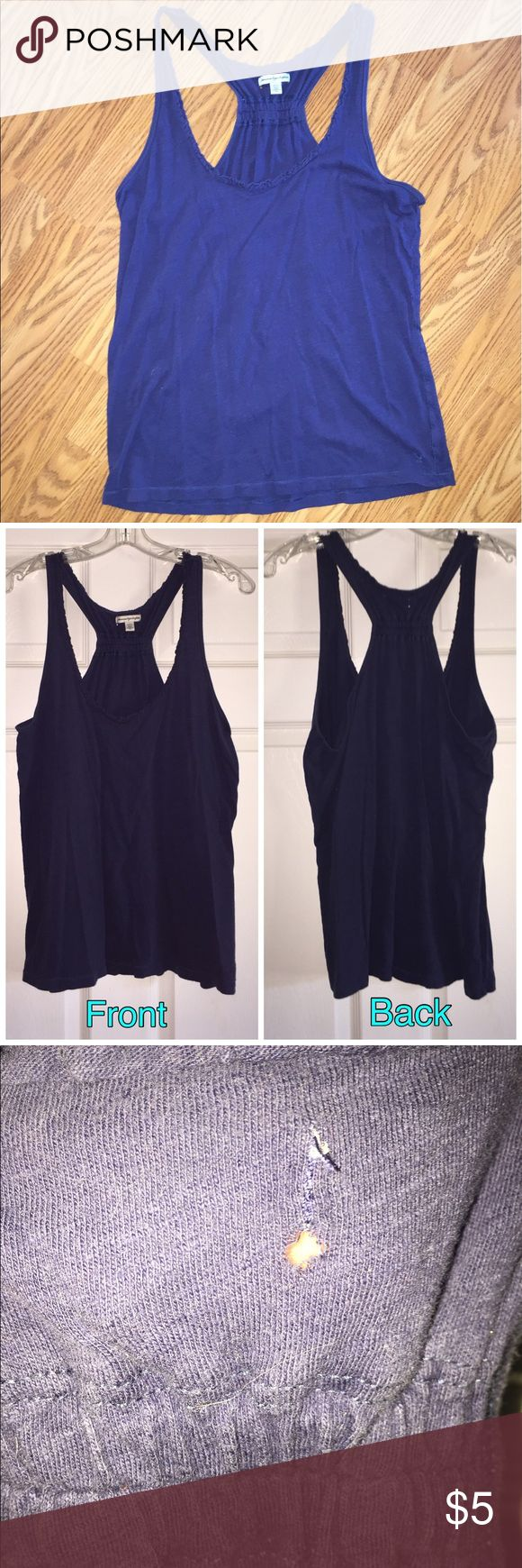 Razorback Tank Top This VERY loved Navy Blue Razorback still has plenty of life left! There's a few small holes in the back around the tag (see third and fourth picture.) Add a white tank top underneath and it'll be a perfect summer shirt! Bundle 3 or more items and save 15%!!! American Eagle Outfitters Tops Tank Tops