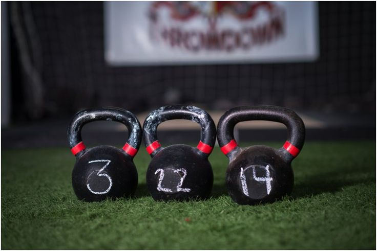 Kettlebell save-the-date w/ us in the background kissing (me in handstand, him in barbell squat)