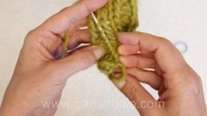 DROPS Knitting Tutorial: How to weave in tails in ribbing. Our sample is a 2 by 2 ribbing. Always weave in your tails on the wrong side of y...
