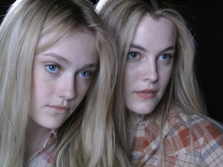 "Riley Keough as Marie Currie and Dakota Fanning as Cherie Currie in ""The Runaways"""