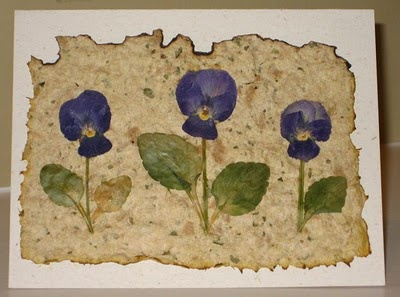 Handmade paper and pressed flowers. I can make this...