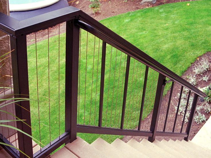 Aluminum railings with vertical cable infill:DesignRail aluminum railing with vertical CableRail infill on stair application.