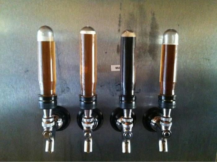 Tap handles made from yeast vials. @ homebrewtalk.com