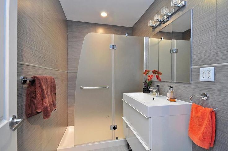 Contemporary 3/4 Bathroom with West Elm Absorbent Lightweight Towels, European Cabinets, frameless showerdoor, Flush