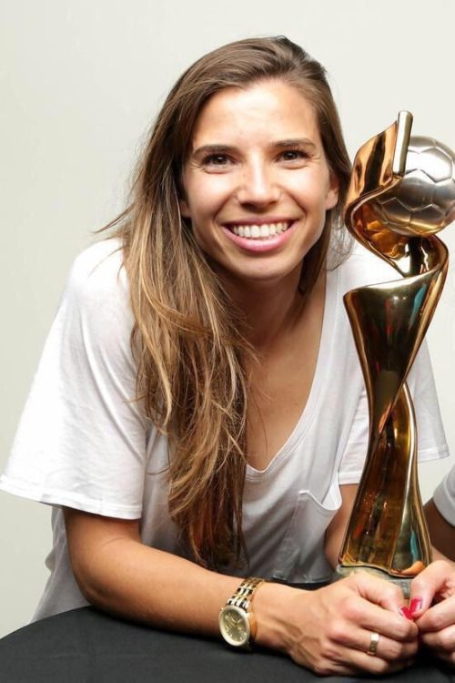 Tobin Heath and the world cup trophy