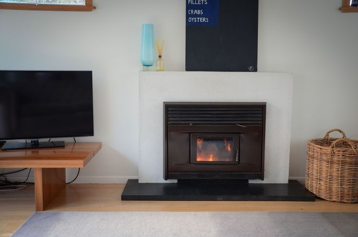 Refurbished fireplace. Plaster and black slate.