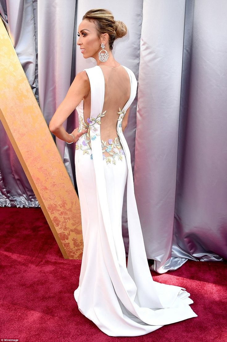 Floral delight: E! host Rancic went with a long white dress with a mini train. The back had beautiful flowers on the netting