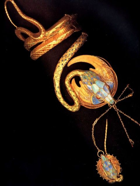Alphonse Mucha. Serpentine Bracelet with Ring. 1899. Gold with enamel, rubies and diamonds. 43 x 62 cm. Private collection. Via All Paintings (http://www.allpaintings.org/v/Art+Nouveau/Alphonse+Maria+Mucha/Sculpture+_+Decoration/Alphonse+Maria+Mucha+-+Serpentine+Bracelet+With+Ring.jpg.html). In search of credits.