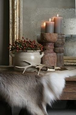 Kacy, mix those antlers with a deer hide and some candles. This is a very handsome arrangement.