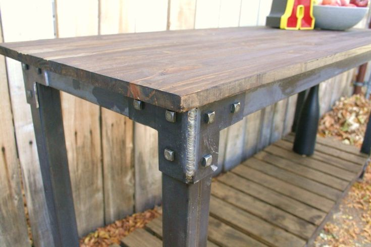 This is a great handmade vintage industrial style occasional table. This industrial chic accent table is 55 wide and 22 deep and 32 high. I seal all my metal with an outstanding sealer with a 10 year warranty for exterior use so inside will last forever, and the top is sealed to resist water and as always I put non scratch leveling feet on my custom furniture, so that is never a worry. The table is full of rivets and blacksmith hardware, and is literally going to last longer than any of us.