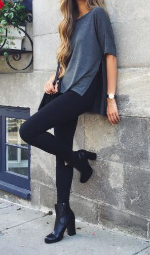 Black jeans, a grey baggy shirt, and a pair of heeled boots can give you a nice, fun, style.