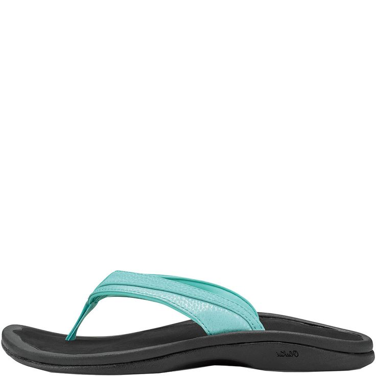 The perfect sandal for the beach and the boardwalk, the Olukai Women's Ohana Sandals in Sea Glass and Black. These water friendly women's Olukai sandals features water-resistant synthetic, or metallic synthetic straps with ultra soft, quick drying jersey knit lining, anatomical compression molded midsole with drop in footbed, razor-siped edges for traction, and embroidered toe-post logo. Aloha!