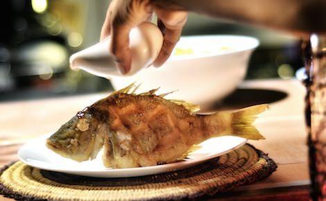 Tamarind sauce added to crispy fried fish.