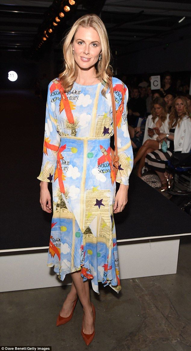 Sporting a multi-coloured dress with a crew neck and slashed hemline, the quirky-but-classic number was a vibrant addition to the front row