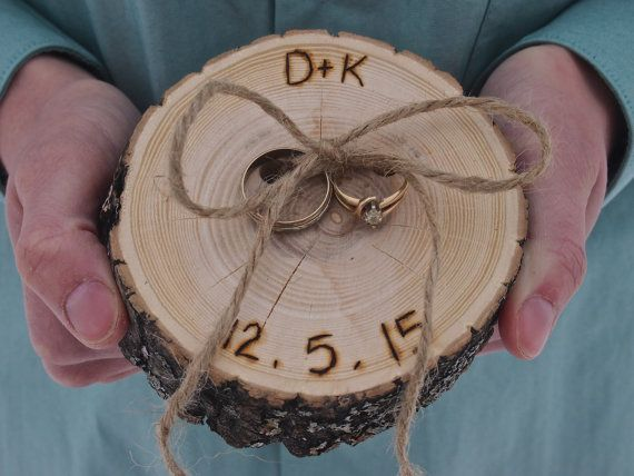 This listing is for a Ring Bearer Ash Wood Slice. My husband will make each slice out of Ash Branches, each will vary slightly. All slices will be approx. 4 inches wide x 1 inch tall (some may be larger or slightly smaller). There are two drilled holes in the slice of wood. For a Touch of Country Charm we added a piece of Jute Twine, to tie your rings on with.  I will personalize each slice, by hand burning on your Initials and Wedding Date. (Please include the initials and date, that you…