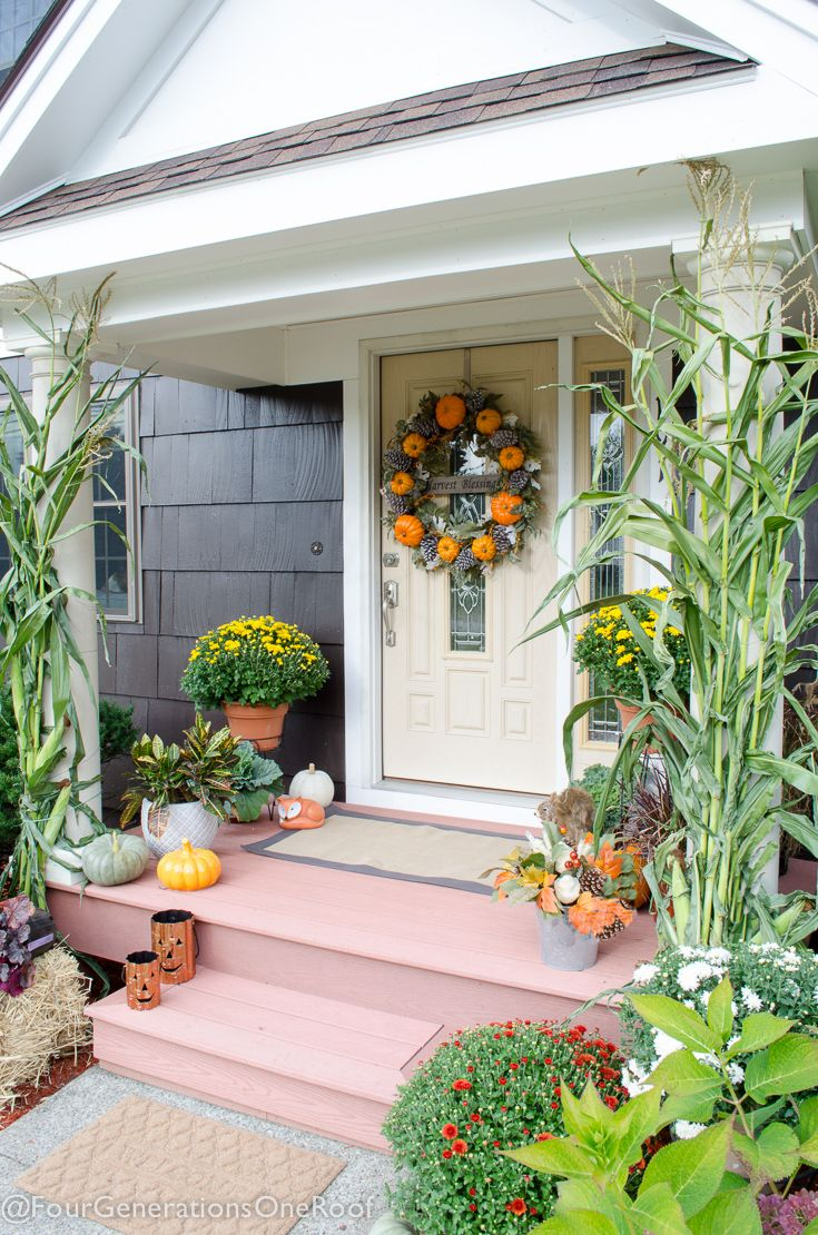 Orange Harvest Front Door decked out for Fall with pumpkins and mums and everything from Homegoods! (sponsored)