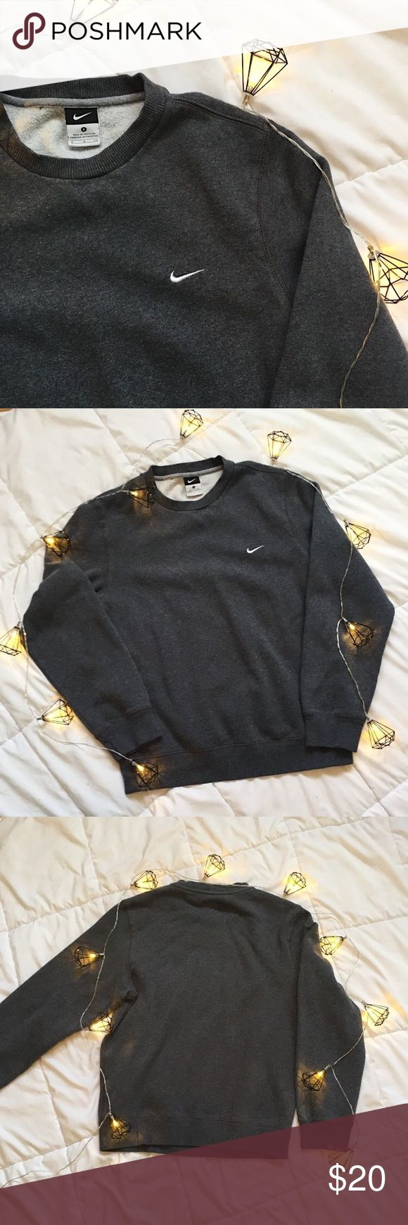 Grey women's Nike crew neck Grey women's Nike crew neck. So comfy and in great condition! Just selling because I have too many jackets. Nike Tops Sweatshirts & Hoodies