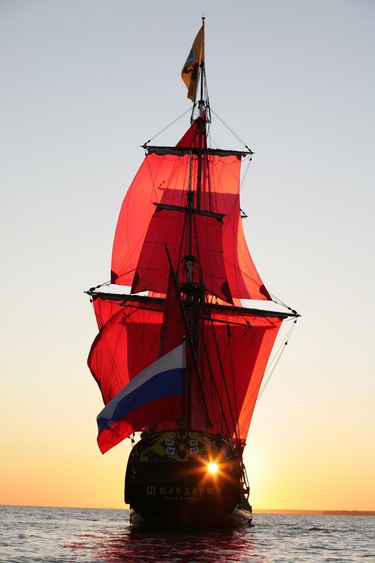 Tall Ship, under red sails,