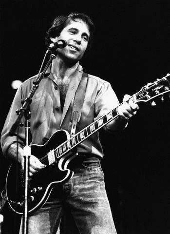 """Paul Simon (born October 13, 1941) is an American musician, singer-songwriter and actor. Simon's fame, influence, and commercial success began as part of the duo Simon & Garfunkel, formed in 1964 with musical partner Art Garfunkel. Simon wrote nearly all of the pair's songs, including three that reached No. 1 on the U.S. singles charts: """"The Sound of Silence"""", """"Mrs. Robinson"""", and """"Bridge over Troubled Water"""