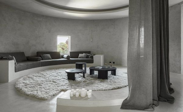An apartment in a concrete silo converted by Axel Vervoordt
