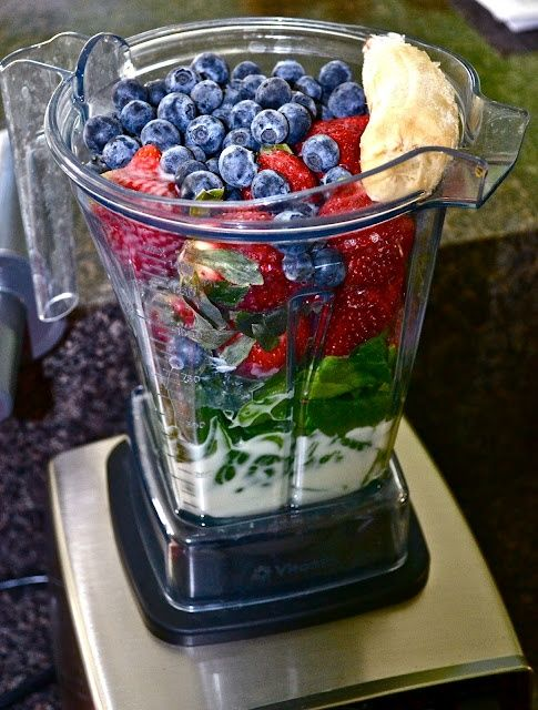 """Slammin' Sunrise """"Green"""" Smoothie Ingredients: 2-3 cups organic spinach 1 cup unsweetened vanilla almond milk 1-2 cups frozen strawberries 1 cup frozen blueberries 1/2 frozen banana 2 tablespoons flaxseeds 2 scoops of protein powder"""