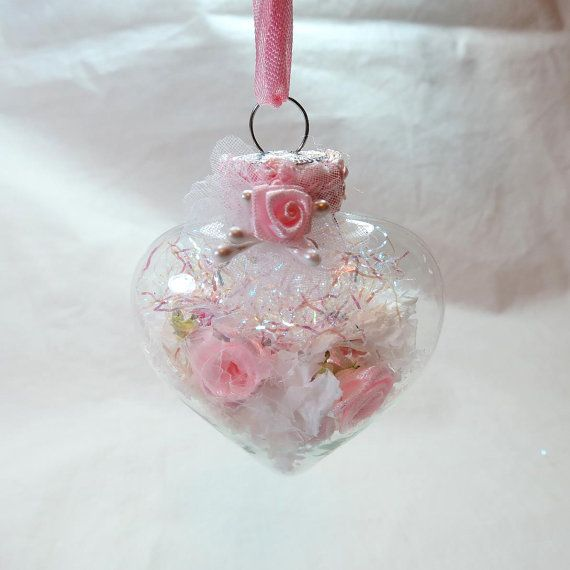 Shabby Chic glass heart shaped home décor or Christmas ornament measures 2X2. Filled with tiny flowers, beads, pearls and fake snow. (sold)
