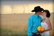 Amazing photo!  Love the color of his shirt and her bouquet against the backdrop.  Almost makes me wish I got married during a tornado.  [The Associated Press: Tornado doesn't stop Kansas couple's wedding day]