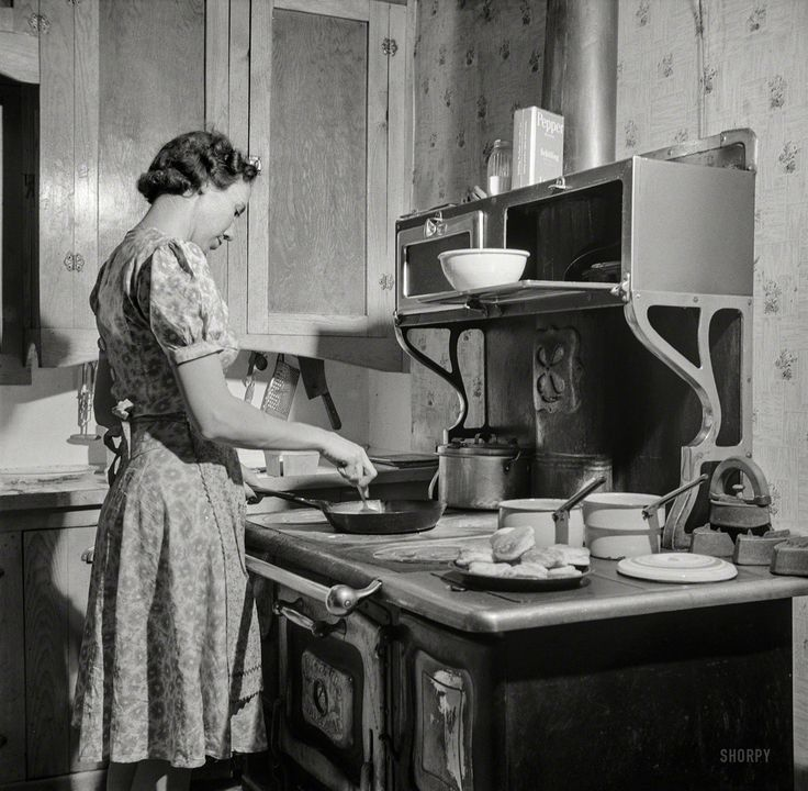 "February 1943. Moreno Valley, New Mexico. ""William Heck ranch. Mrs. Heck getting supper."" Photo by John Collier."